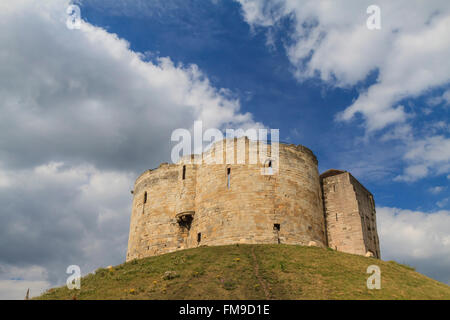 The famous Clifford's Tower with blue sky, York, United Kingdom - Stock Photo