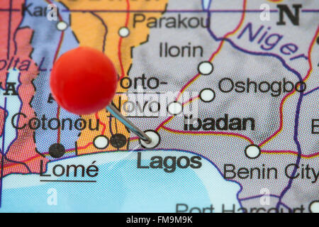 Close-up of a red pushpin in a map of Lagos, Nigeria. - Stock Photo