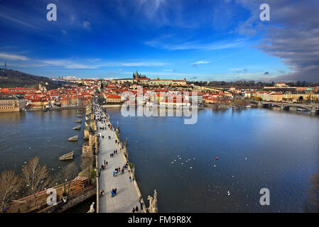 Charles' Bridge, Vltava river, Mala Strana and Prague Castle. View from one of the Towers of the bridge - Stock Photo