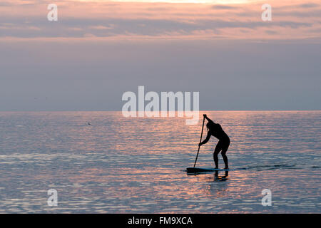 Cardigan bay Aberystwyth Wales UK, Friday 11 March 2016 UK Weather : As the suns gets over Cardigan Bay on the west - Stock Photo