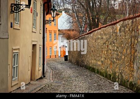 Walking in picturesque Novy Svet neighborhood, in Hradcany (Castle's neighborhood), Prague, Czech Republic - Stock Photo