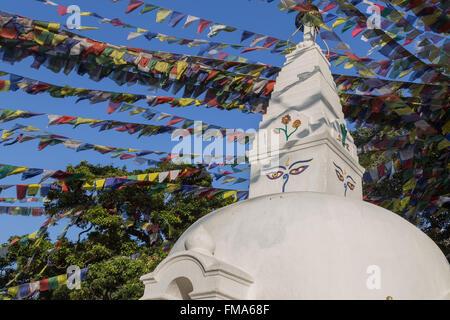 Small buddhist stupa with prayer flags at Swayambunath temple in Kathmandu, Nepal. - Stock Photo