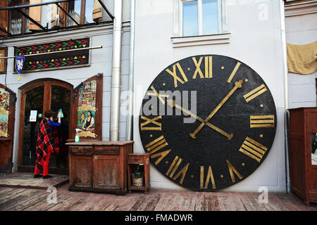 Lviv, Ukraine - January 30, 2016: The Wall Clock at the entrance to the restaurant - Stock Photo