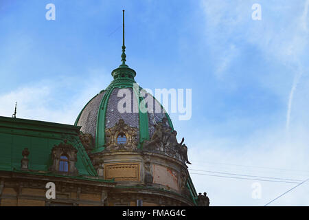 Lviv, Ukraine - January 30, 2016: View of The Sitting Statue of Liberty on the roof of the Museum of Ethnography - Stock Photo