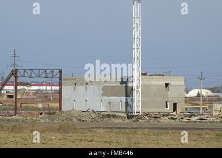 Building under construction. The construction of auxiliary buildings at the refinery. - Stock Photo