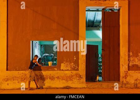 Cuba, Holguin, Gibara, Ocher facade of a house - Stock Photo