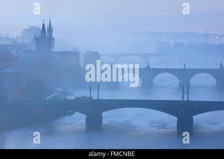 Bridges on Vltava (Moldava), river, Prague, Czech Republic. The one in the middle is the famous Charles' bridge. - Stock Photo
