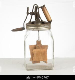 Antique butter churn - Stock Photo