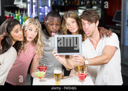 Friends taking selfie with a tablet - Stock Photo