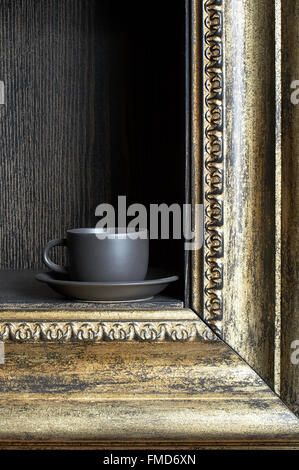 Black cup on a shelf in the form of a frame - Stock Photo