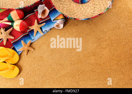 Mexican beach background with sombrero straw hat, traditional serape blanket, starfish, seashells and maracas.  - Stock Photo