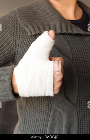 Thumbs up with bandage - Stock Photo