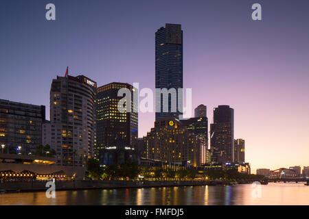 Eureka Tower and skyline along Yarra River at dusk, Melbourne, Victoria, Australia - Stock Photo