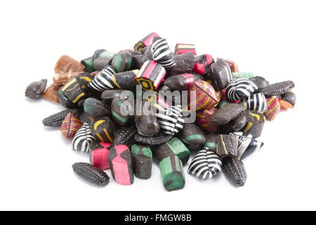 Pile of black and colored liquorice rock candy pieces - Stock Photo