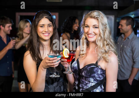 Portrait of friends having a drink - Stock Photo