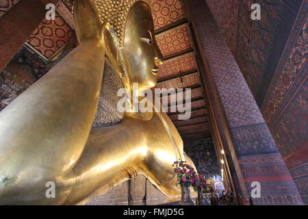 Reclining Buddha, Wat Pho, Bangkok, Thailand - Stock Photo