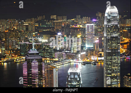HONG KONG - JULY 03: Cityscape of Hong Kong island from Victoria peak on July, 03, 2012. The Victoria Harbour is - Stock Photo