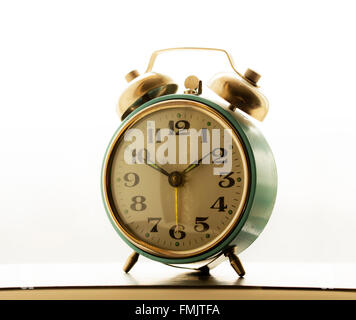 big old clock vintage mechanical alarm clock old bracket clock stock photo