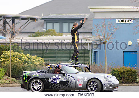Edinburgh, UK. 12 March, 2016.  Stunt driver Terry Grant waves to the crowd during the Carole Nash MCN Scottish - Stock Photo