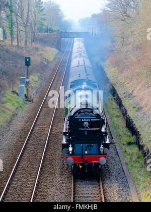 Reigate, Surrey, UK. 12th March, 2016. The Belmond British Pullman Tornado Steam Train LNER A1 Class 4-6-2 no 60163 - Stock Photo
