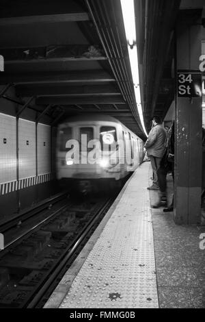 Subway Train coming into the station - Stock Photo