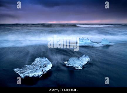 Icebergs on Jokulsa Volcanic Beach at Twilight, Jokulsarlon, Near Hofn, Southern Iceland - Stock Photo