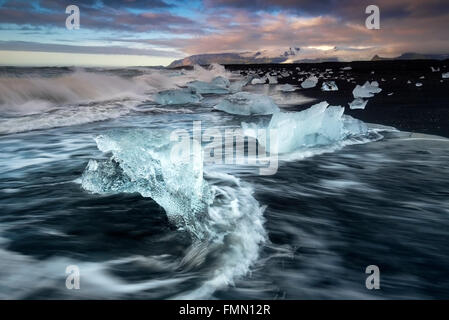 Icebergs washed up on Fellsfjara Volcanic Beach, near Jokulsarlon, Southern Iceland - Stock Photo