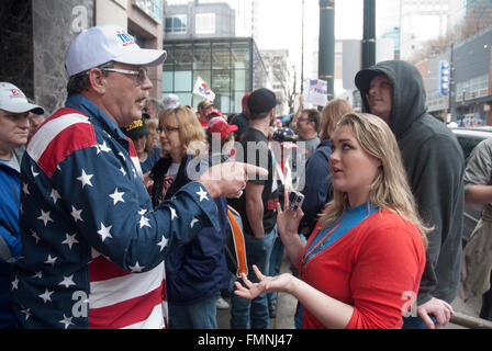 Kansas City, Missouri, USA, 12th March, 2016 Supporter of Donald Trump (L) while standing in line to get into the - Stock Photo