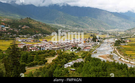 Overlooking Paro with the Paro River or Pa Chu and yellow rice fields, Paro valley, Himalayas, Kingdom of Bhutan - Stock Photo