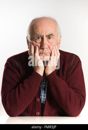 old senior man having problems, thinking, beeing serious - Stock Photo