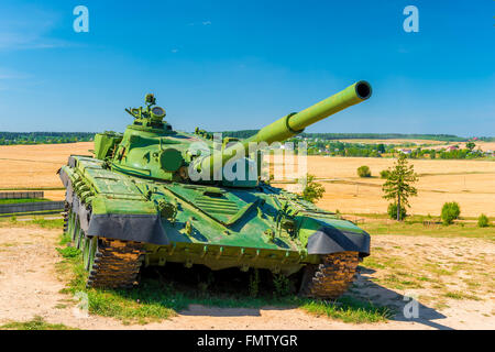 fighting tank T-72 green color in the field - Stock Photo