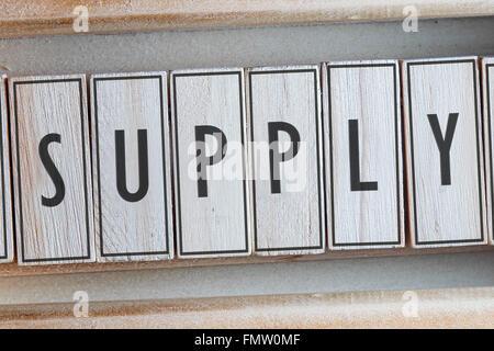 Supply word written on wood - Stock Photo