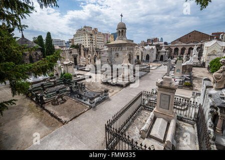 Graves at Poblenou Cemetery - Cementiri de l'Est (East cemetery) in Barcelona, Spain - Stock Photo