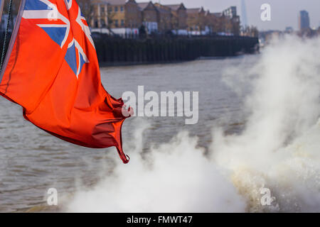 Union Jack flag over Thames river in London. - Stock Photo