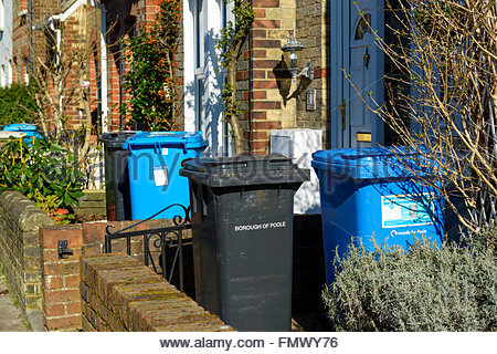 Wheelie bins in front garden, Poole, Dorset, England, UK - Stock Photo