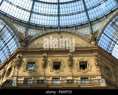 Intersection of glass vaulted arcades of Galleria Vittorio Emanuele II. - Stock Photo