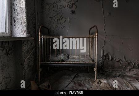cot in Pripyat, Chernobyl scene of 1986 nuclear disaster - Stock Photo