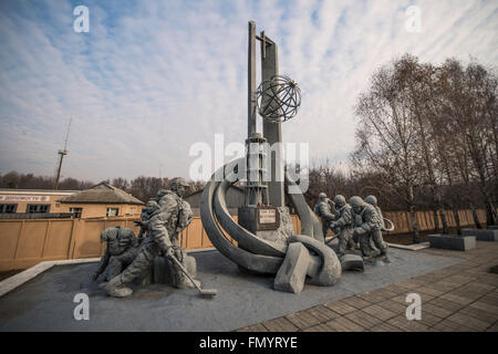 Monument dedicated to firefighters and rescuers that were on the scene on the day of the disaster in Pripyat, Chernobyl - Stock Photo