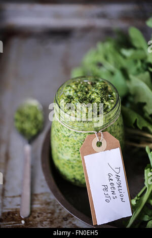 Homemade dandelion greens pesto - Stock Photo