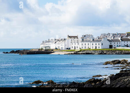 View across bay in Loch Indaal to Scottish village of Port Charlotte on Isle of Islay Inner Hebrides Argyll & Bute - Stock Photo