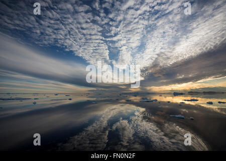 Antarctica, Antarctic peninsula, Weddell Sea, sunset with reflections - Stock Photo