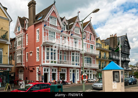 An attractive pink and white building built in 1889 close to the river and now being used as a public house serving - Stock Photo
