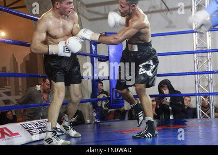 Kiev, Ukraine. 12th March, 2016. Afro-Ukrainian 19 years old welterweight Vlad Baranov attacks Georgian Nikoloz - Stock Photo