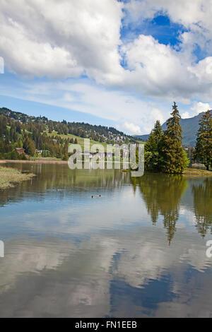 Small alpine lake Heidisee in Lenzerheide, Switzerland - Stock Photo