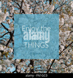 Enjoy the little things text with white flowers in the background - Stock Photo