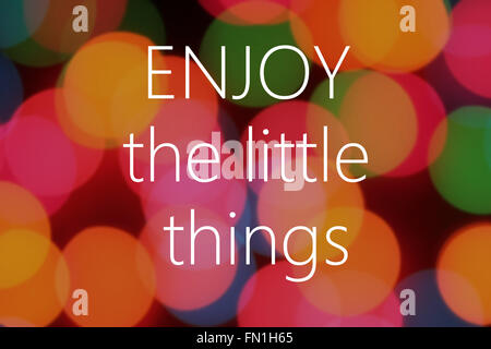 Enjoy the little things text on colorful bokeh background - Stock Photo