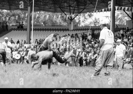 Wrestlers Turkish pehlivan at the competition in traditional Kirkpinar wrestling. - Stock Photo