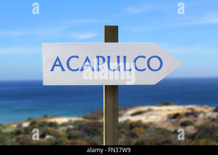 Acapulco road sign with seashore in the background - Stock Photo