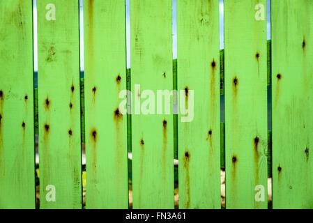 Green fence, La Bussola Italian Restaurant, Dutchman's Bay, Coolidge, Antigua - Stock Photo