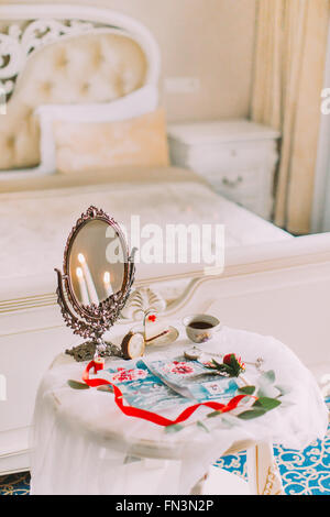 Beautiful white vintage table with mirror in victorian style. Tea time - Stock Photo